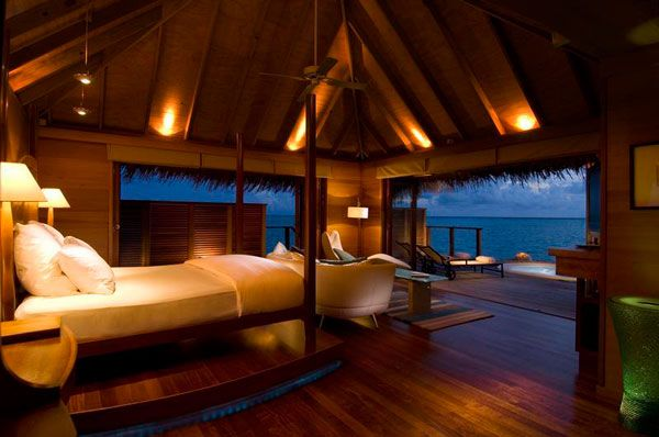 cool-ocean-view-bedroom-interior-decor-with-inspiring-lighting-and-bed-sofa-lamps-folding-glass-door-ceiling-fan-wooden-flooring-and-lounge-on-terrace-ideas.jpg
